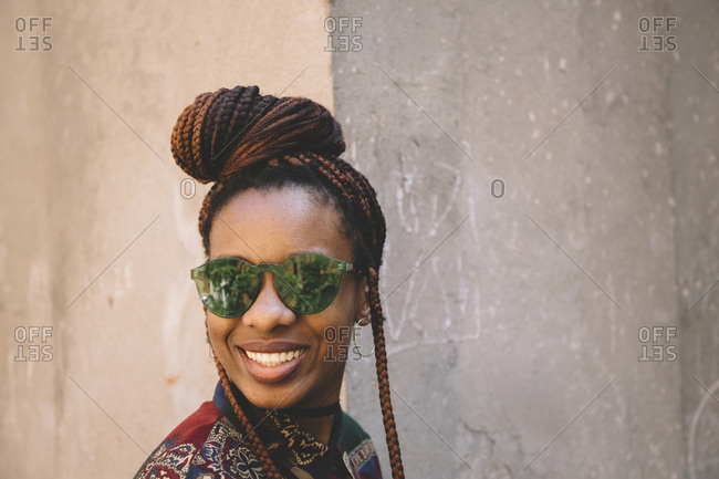 African american woman with green sunglasses