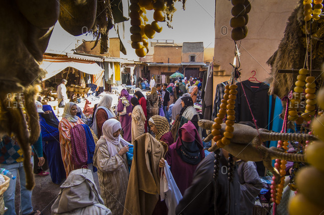 Marrakech, Morocco - March 4, 2017: Busy street scene inside on Souk District