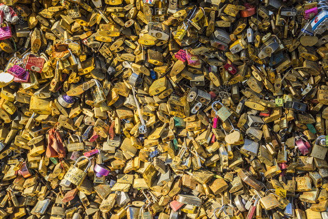 Paris, France - November 11, 2014: Love locks at Pont de l'Archeveche, near Notre Dame Cathedral