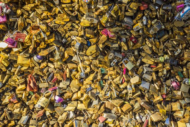 Paris, France - November 11, 2014: Love locks at Pont de l'Archeveche, near Notre Dame Cathedral