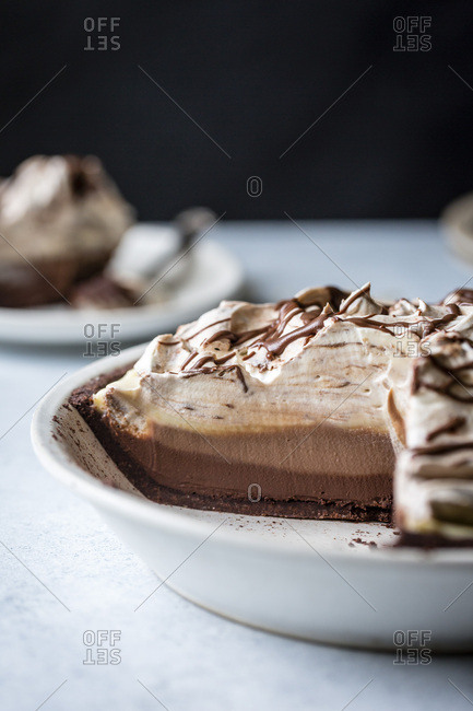 A layered triple chocolate pie, sliced