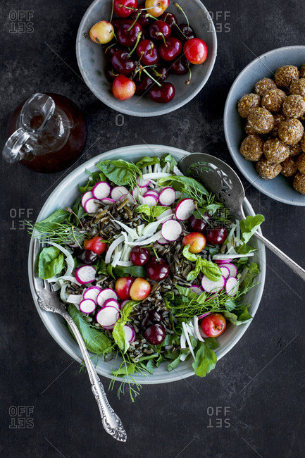 Cherry Wild Rice Salad with Hibiscus Vinaigrette served with white wine