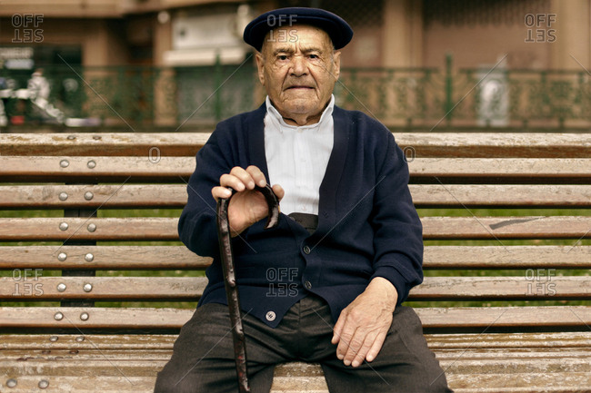 8a91de74e331f An old Basque man wears a traditional Basque beret and is sitting with his  stick on a bench in Bilbao stock photo - OFFSET