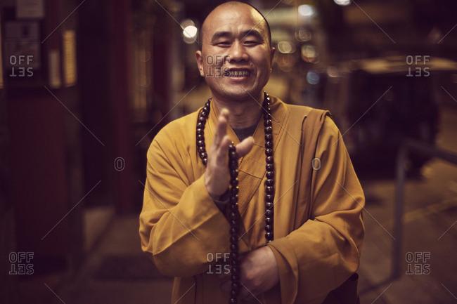 Hong Kong, People's Republic of China - February 6, 2011. A smiling Buddhist monk in Hong Kong