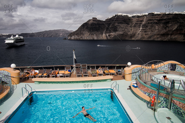Santorini , Greece - October 16, 2013. A beautiful view from a cruise ship with a swimming pool at the Aegean Sea, Greece