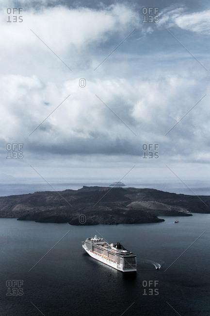 Santorini , Greece - October 16, 2013. A cruise ship sailing in the Aegean Sea in Santorini