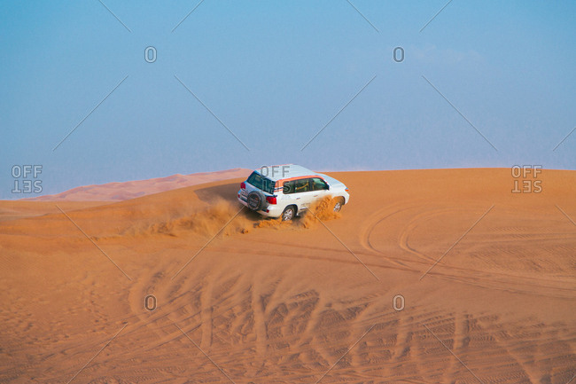 Dubai, United Arab Emirates - November 16, 2014. A driver seen doing desert safari in Dubai