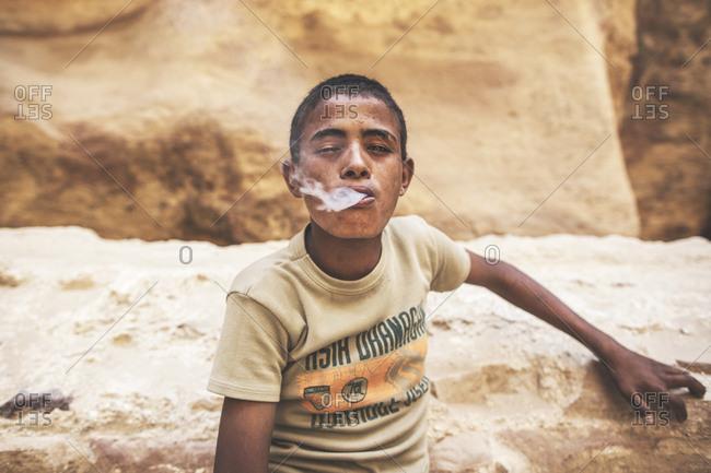 Petra, Jordan - 13, September 2015. A young Jordanian boy is smoking a cigarette