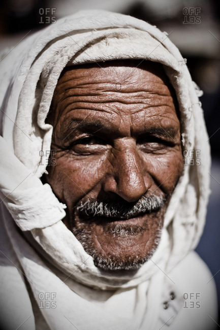 Cairo, Egypt - October 19th, 2008. A local smiling Egyptian man wearing a traditional rural turban