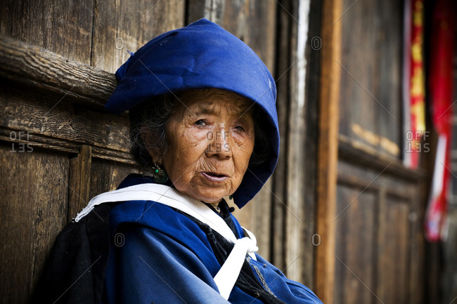 Yunnan, People's Republic of China - July 6, 2009. A local woman from the Naxi ethnic minority in the Yunnan Province