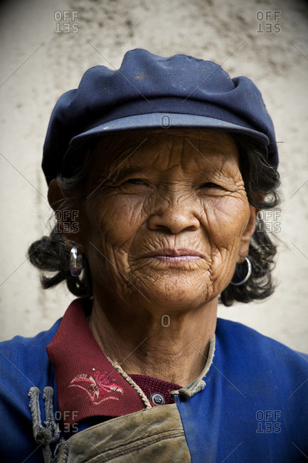 Yunnan, People's Republic of China - July 6, 2009. A woman from the Naxi ethnic minority in the Yunnan Province