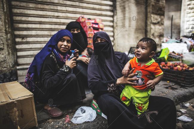 Amman, Jordan - 11, September 2015. Three women with a child wearing hijab and niqab in Amman, Jordan