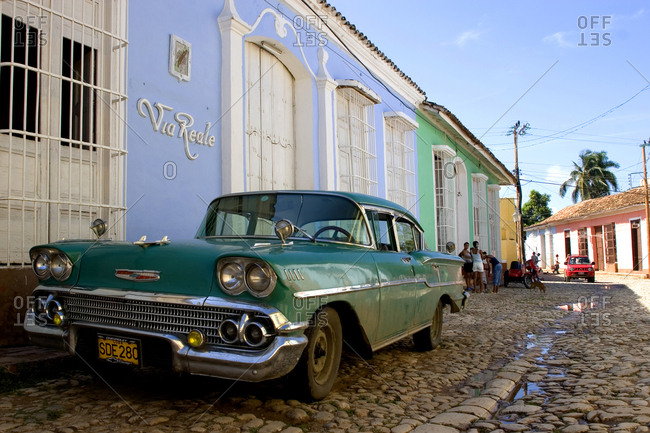 Trinidad, Republic of Cuba - June 16th 2006. A pre-embargo American car, also known as Yank Tank, parked on a street