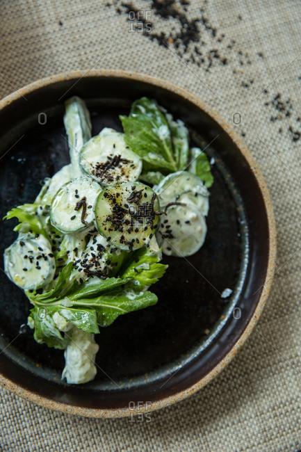 Cucumber salad garnished with black sesame seeds