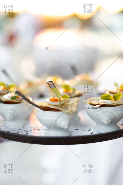 Small dishes on a serving platter with a pita point and slice of soft-boiled egg