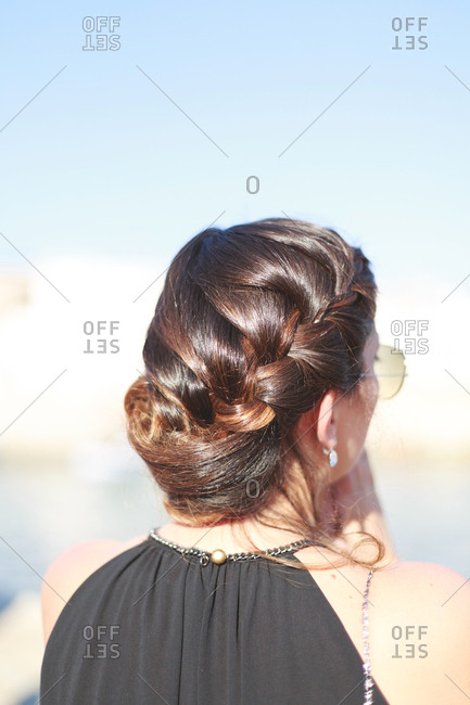 Woman in a black formal gown with an elegant braided hairstyle