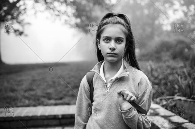 Tween girl before school in black and white