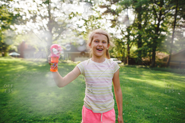 Little girl with a bubble gun