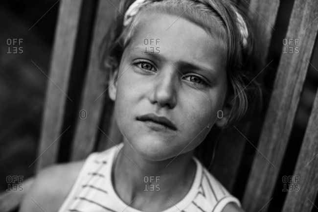 Little girl with tears in her eyes in black and white