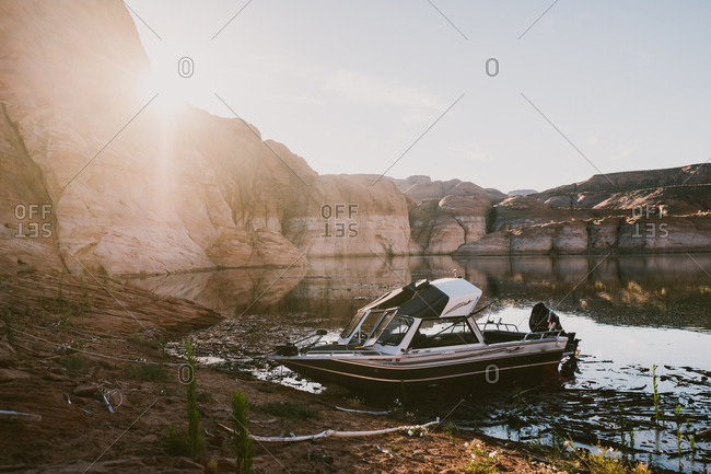 Boat on Lake Powell at sunset