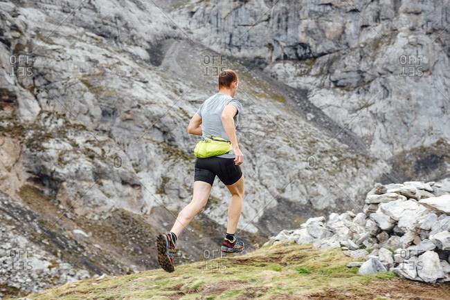 Trail runner on the running near Torre Cerredo, Asturias, Spain