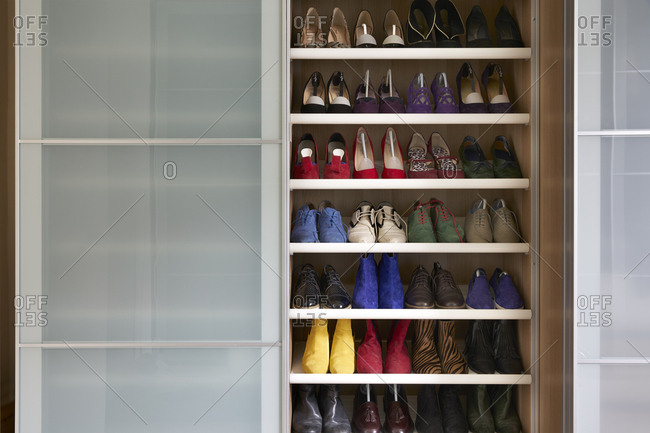 London, England - June 22, 2017: Interior view of wardrobe with shoes on shelves