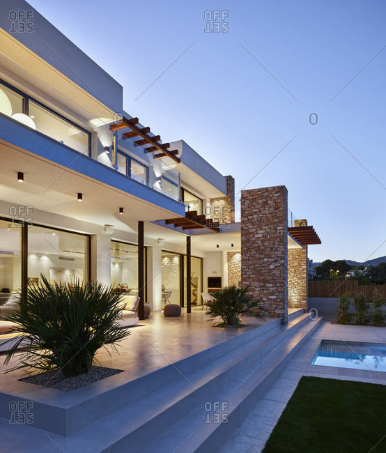 Exterior view of J&P House - White Houses, Lamella de Mar - Port Calafat, Spain Garden facade and swimming pool at dusk