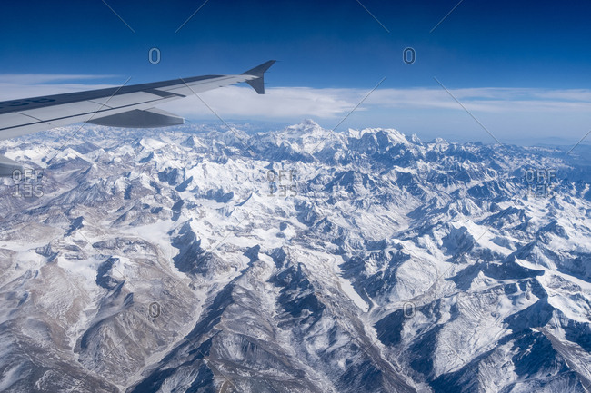 A jet in flight above the mountains of the high Tibet plateau