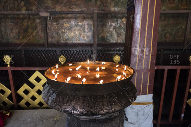 Yak butter candles burning in Jokhang Temple