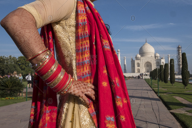 An Indian woman, with henna on her hand and arm, visits the Taj Mahal
