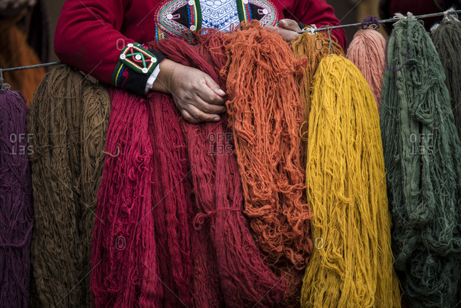 Quechuan women of Chinchero weave traditional clothes in traditional ways for sale