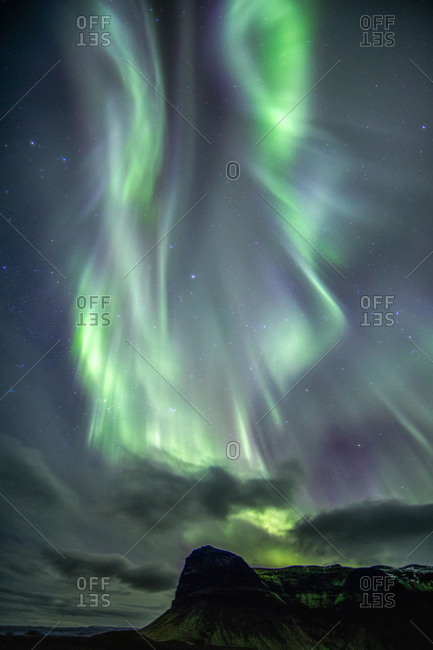 The northern lights above a mountain range on Iceland's south coast