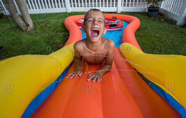 Boy on an inflatable waterslide