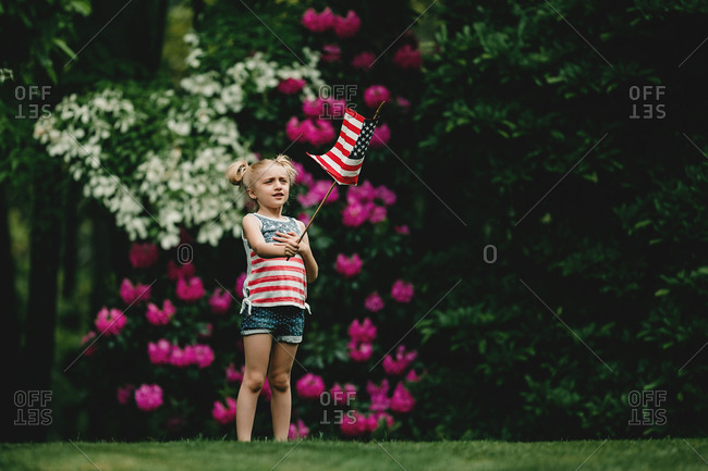 Girl holding up an American flag