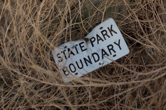 Sign for state park in grass