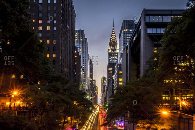 New York City, New York - July 21, 2014: Views down 42nd Street and from the Tudor City bridge at sunset, dusk and night in Manhattan in New York City, New York