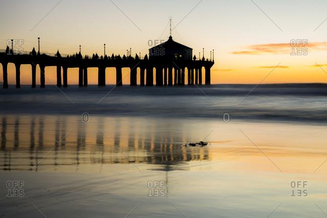 Views of the Manhattan Beach Pier and beach at sunset at Manhattan Beach in Los Angeles, California