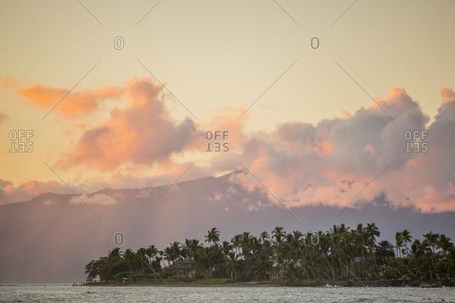 Sunset off the coast of Maui island in Hawaii