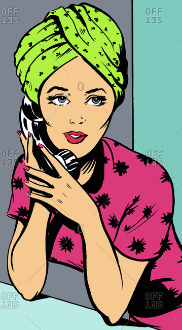 Woman with hair wrapped in towel talking on telephone