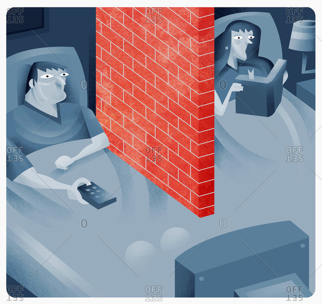 Couple in bed with brick wall between them