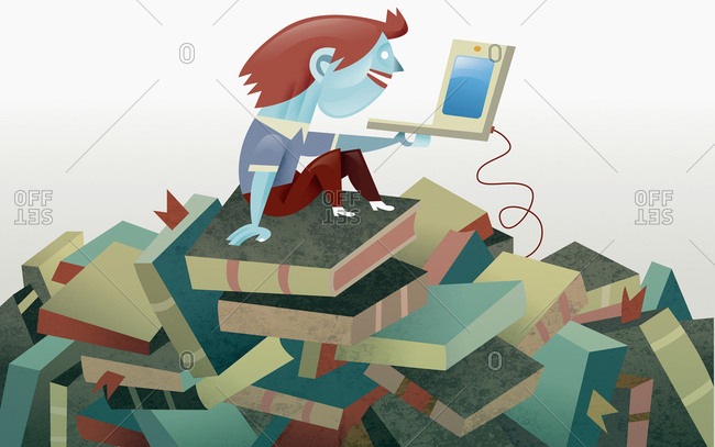 Boy with laptop sitting on pile of books