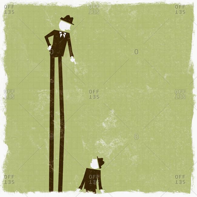 Tall businessman pointing down at short businessman