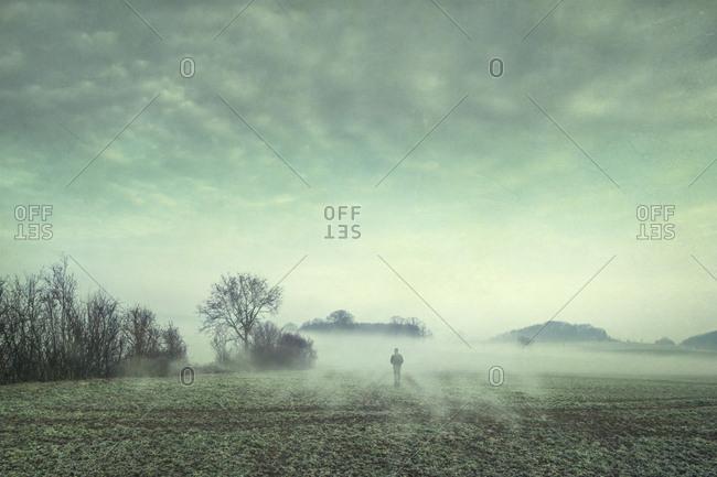 Man on field in fog- composite
