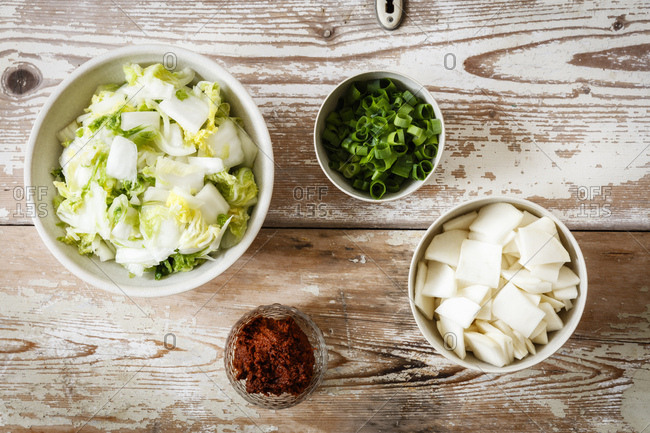 Ingredients for Korean kimchi- Chinese cabbage- radish- spring onions and paprika