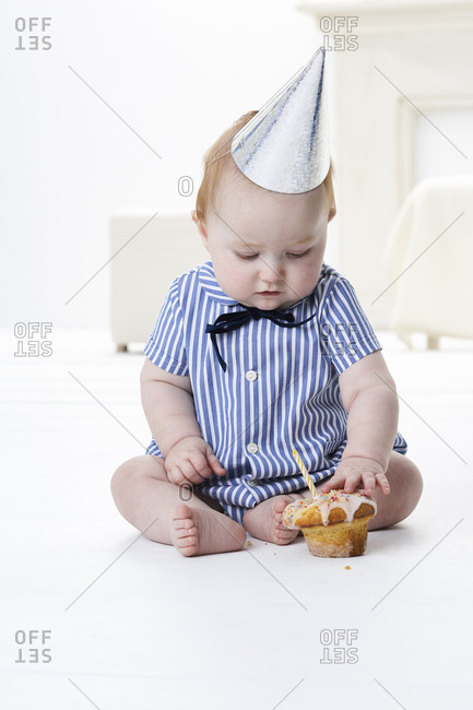 Baby boy testing birthday cake