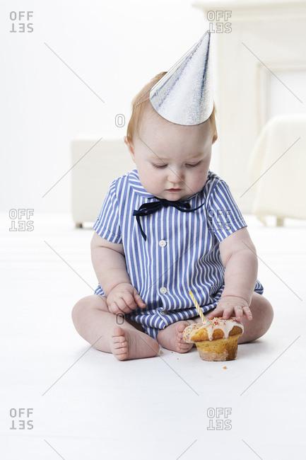 Baby boy testing birthday cake