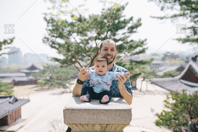 South Korea- Seoul- Father and baby girl visiting Changdeokgung Palace and Huwon