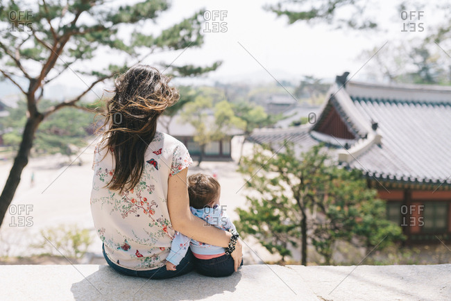 South Korea- Seoul- Mother and baby girl visiting Changdeokgung Palace and Huwon