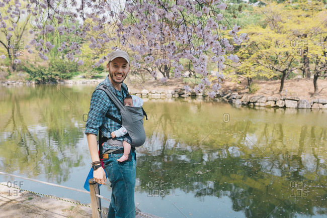 South Korea- Seoul- Father and baby girl visiting Changdeokgung Palace