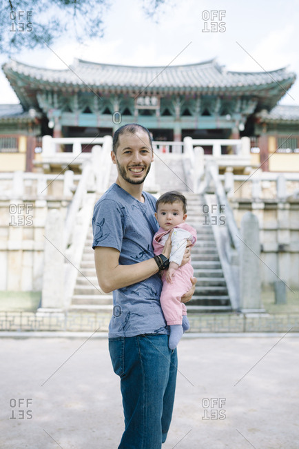 South Korea- Gyeongju- father traveling with a baby girl in Bulguksa Temple
